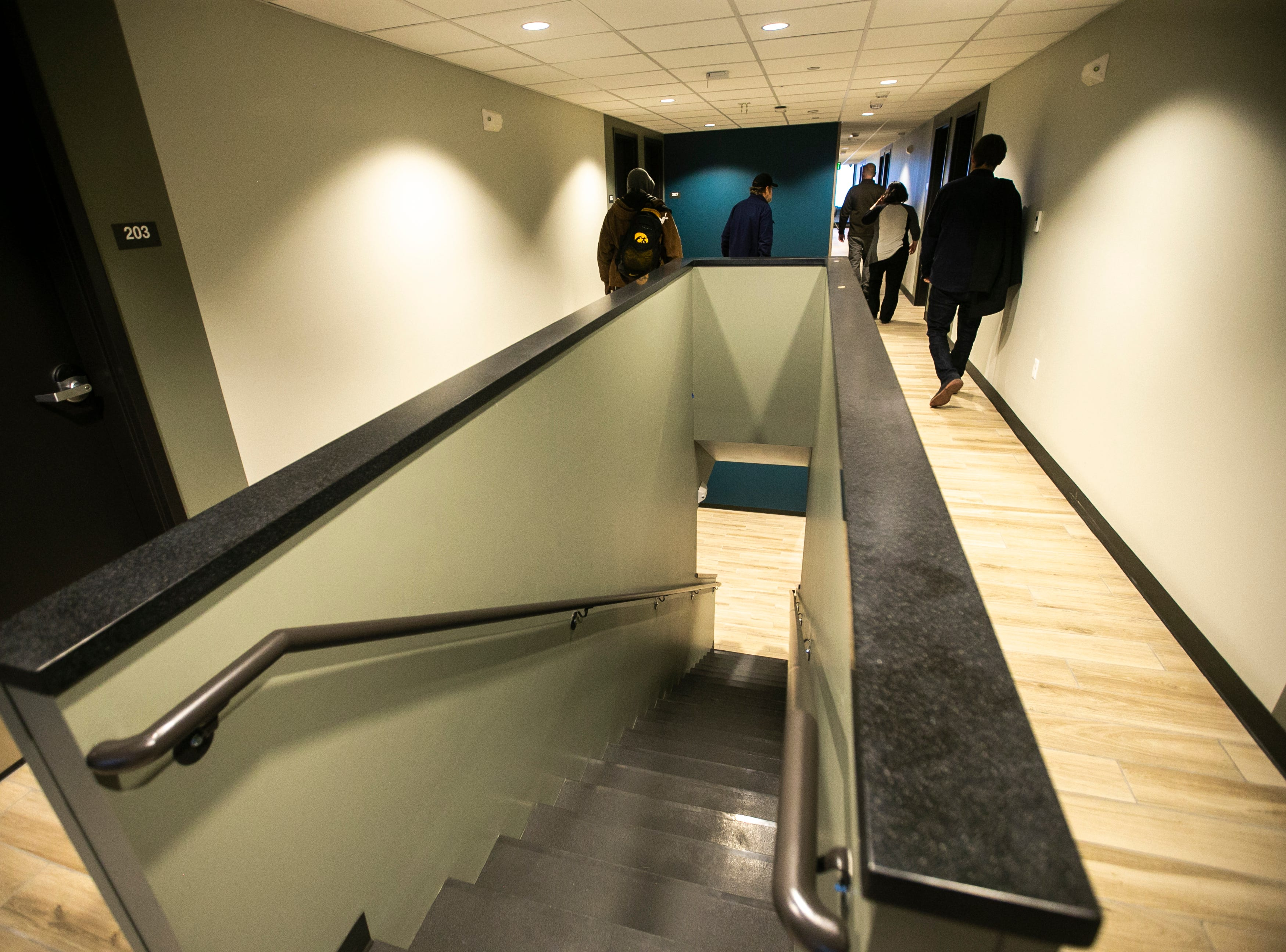 A staircase leading to the first floor of the newly completed homeless housing apartment complex is seen on Wednesday, Jan. 16, 2019, at Cross Park Place in Iowa City, Iowa. The complex has 24 individual units, offers free laundry and has an elevator.