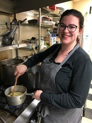 Jordan Yamas stirs a pot of lima beans at The Hungry Goat.