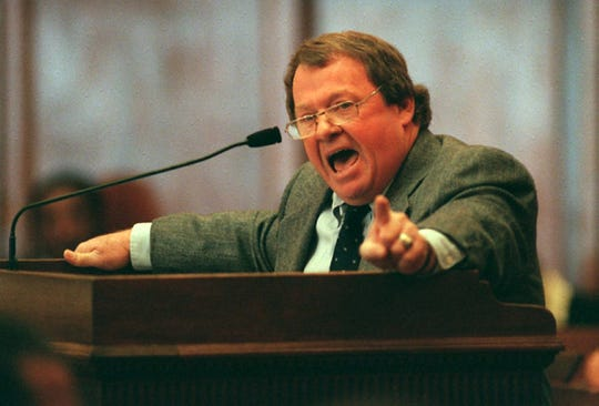 This 1999 photo shows Rep. Ed Perry, D-Oxford, encouraging lawmakers to override Gov. Kirk Fordice's veto of a campaign finance reform proposal on the opening day of the Legislature in Jackson, Miss.