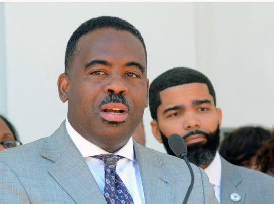 Robert Blaine, front left, Jackson's chief administrative officer, has been censured by the Jackson City Council. Mayor Chokwe Antar Lumumba, in background, criticized the action.