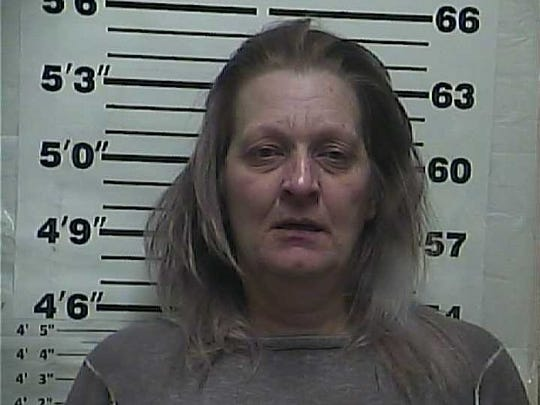Donna Landrum, 50, was charged with introduction of drugs into a county jail after officials found a pill bottle hidden under her pants as she was being booked into Weakley County Jail on another charge.