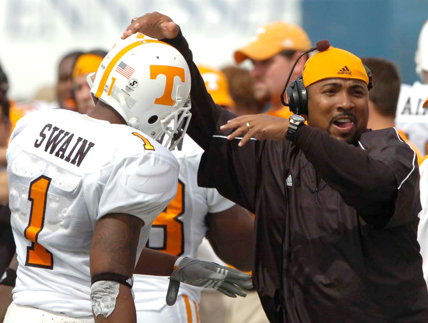 Tennessee assistant coach Trooper Taylor congratulates wide receiver Jayson Swain after Swain scored a touchdown on Saturday in Memphis. The Vols beat the Tigers 41-7, improving to 4-1 for the season.