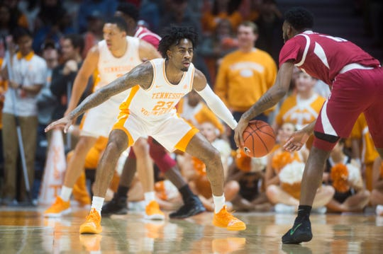 Tennessee's Jordan Bowden (23) defends an Arkansas player during a NCAA men's basketball game between Tennessee and Arkansas at Thompson-Boling Arena Tuesday, Jan. 15, 2019.