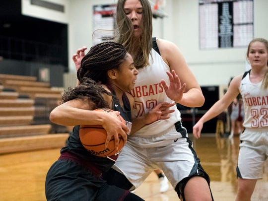 Oak Ridge's Jada Guinn (24) makes her way to the basket while guarded by Central's Ashton Blair (23) on Tuesday, January 15, 2019.