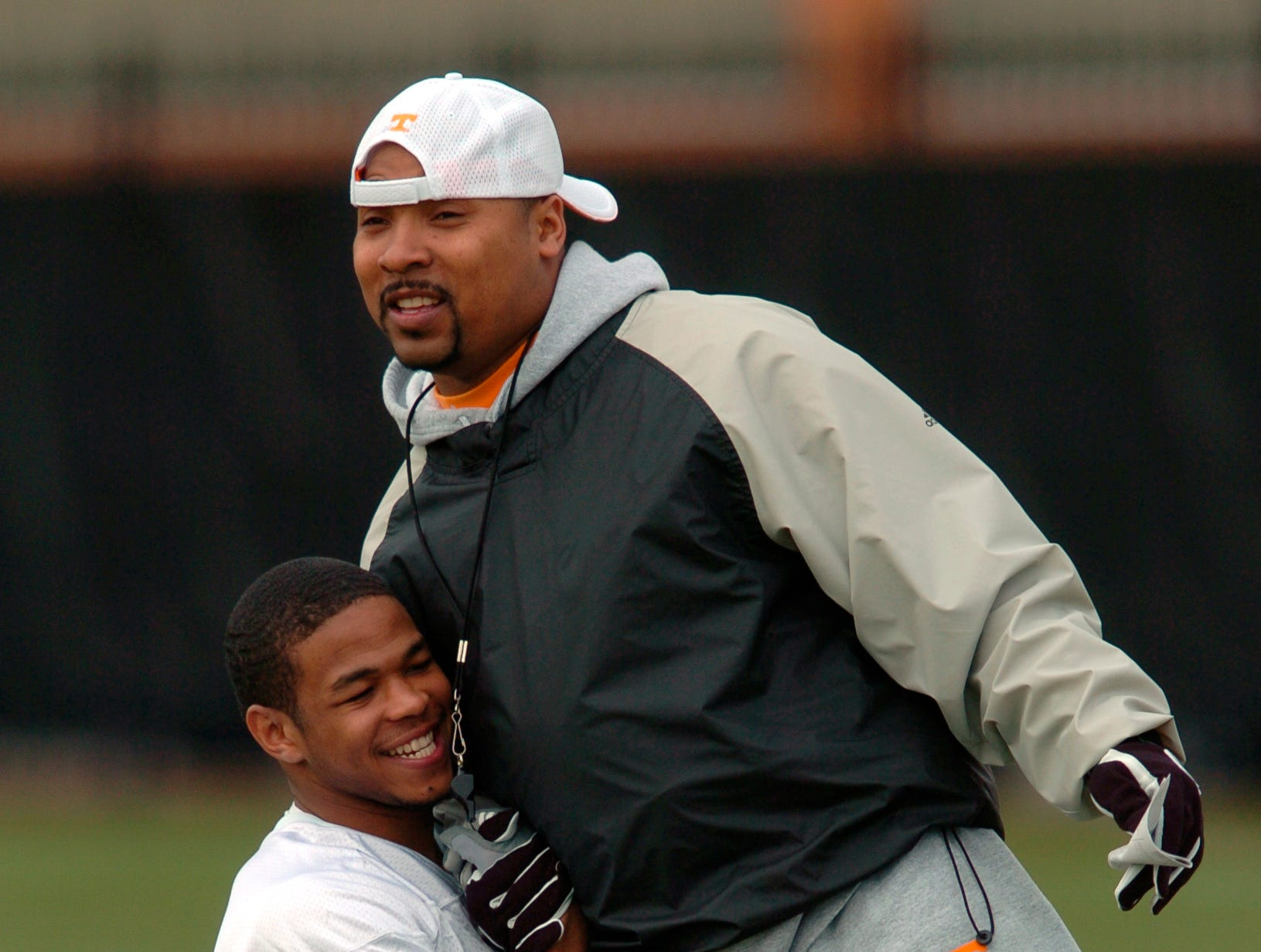 0310UTF.JA#3207.jpg --Sports --  Tennessee running backs coach Trooper Taylor jokes around with Inquoris Johnson during the Vols first spring practice Thursday afternoon on Haslam Field.Jeff Adkins/NEWS SENTINEL ----03/10/2005