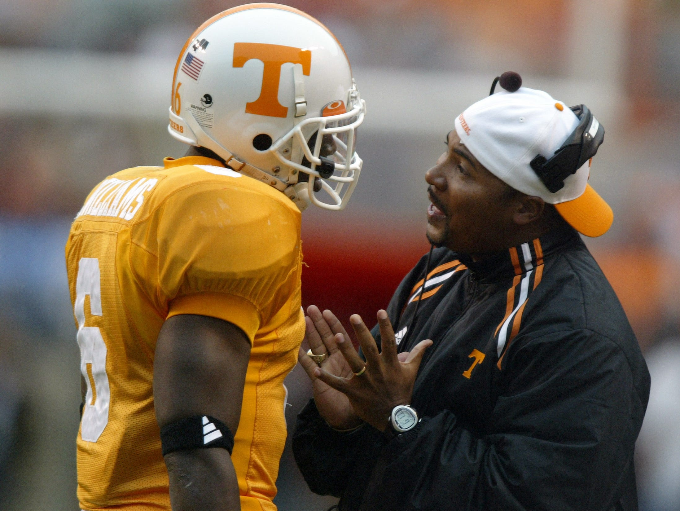 utuga23.cc#4445.jpg---sports---Tennessee assistant coach Trooper Taylor talks with freshman tailback Ja'Kouri Williams during UT's loss to Georgia.