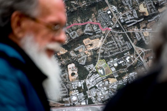 Community members examine a map during a Knoxville-Knox County Planning public meeting at Hardin Valley Academy on Jan. 15. Public input is being sought as the city updates its one-year comprehensive development plan.