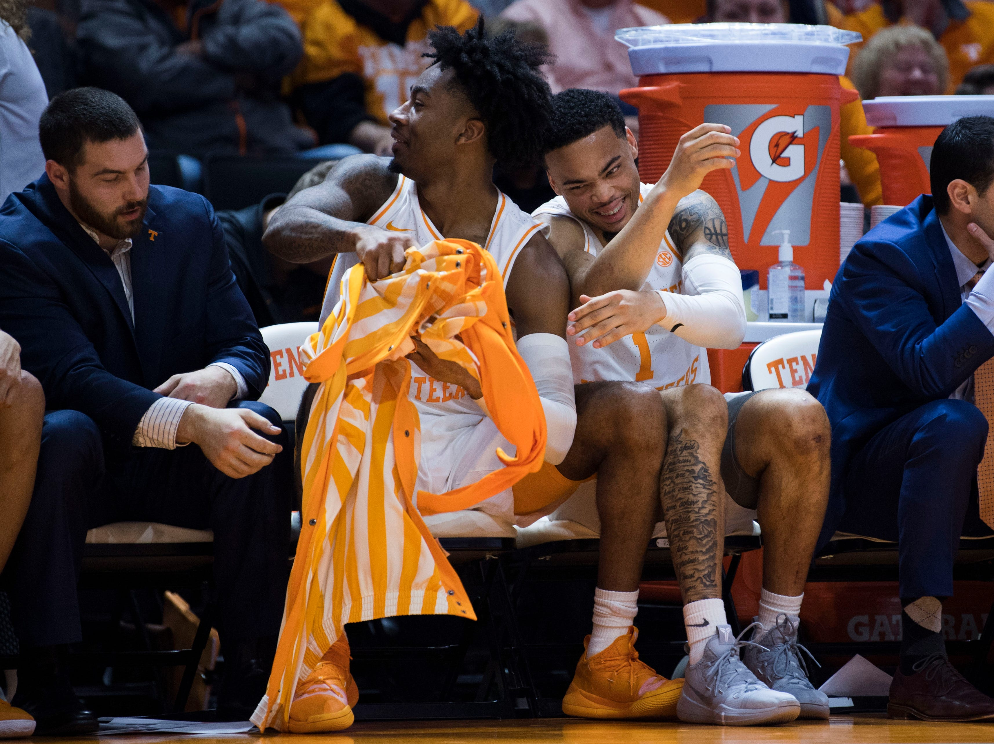 Tennessee's Jordan Bowden (23) and Tennessee's Lamonte Turner (1) laugh after Bowden ripped Tennessee's Brock Jancek's (34) pants off to go into the game in the final seconds, during a NCAA men's basketball game between Tennessee and Arkansas at Thompson-Boling Arena Tuesday, Jan. 15, 2019. Tennessee defeated Arkansas 106-87.