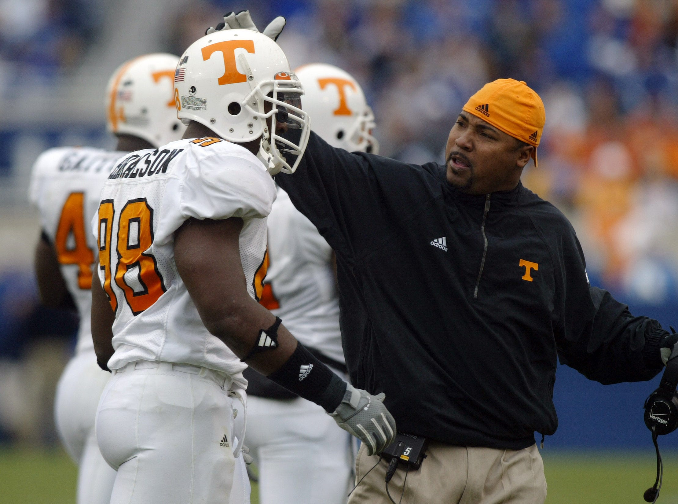UTKY19.CC#4771.JPG------SPORTS------Tennessee assistant coach Trooper Taylor encourages Parys Haralson as he comes off the field during UT's 27-8 win over Kentucky.
