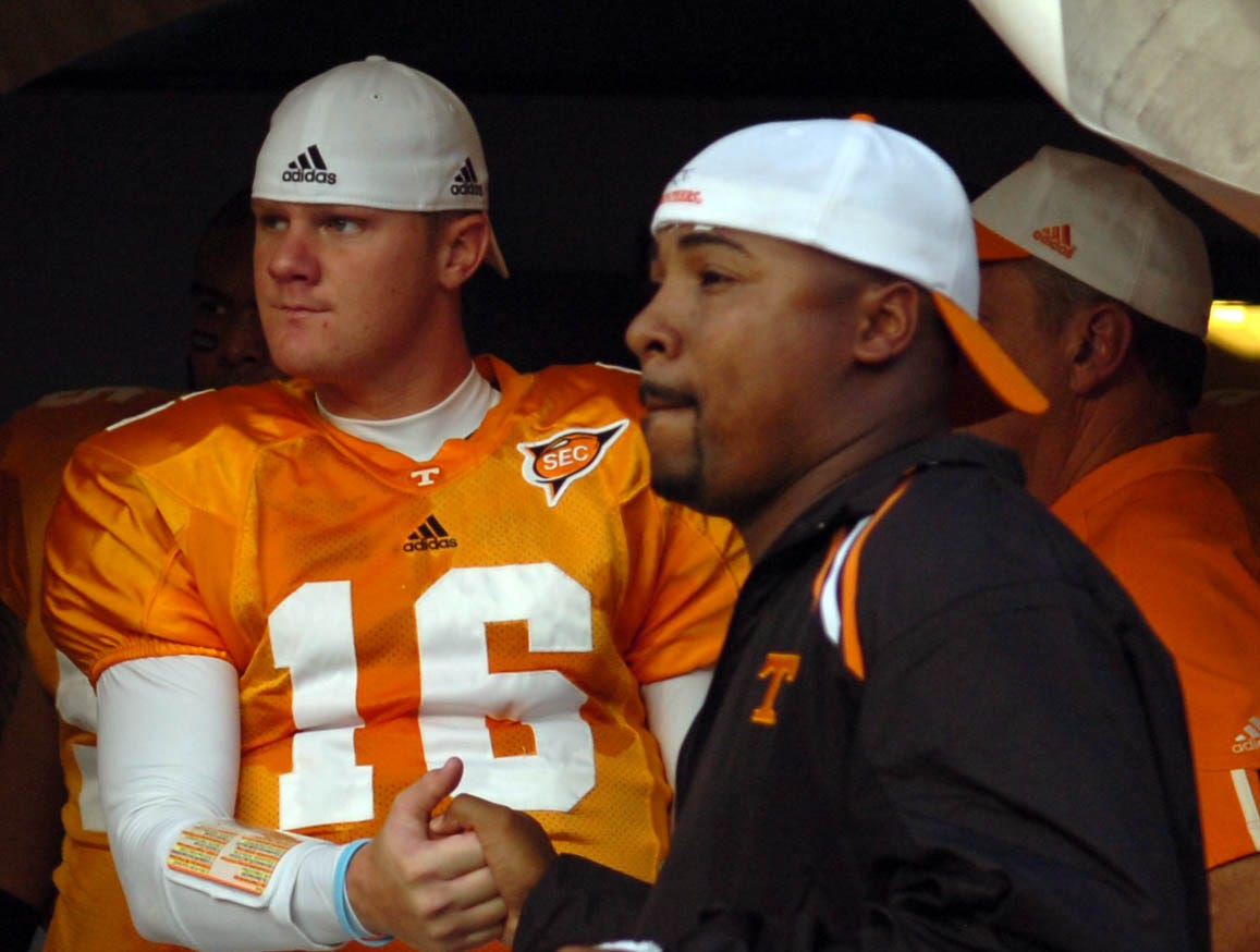 utlsu15.ASB#4379.JPG--SPORTS-- UT quarterback Rick Clausen with assistant coach Trooper Taylor before the start of the LSU game Monday in Baton Rouge. Tennessee defeated LSU 30-27 in overtime.