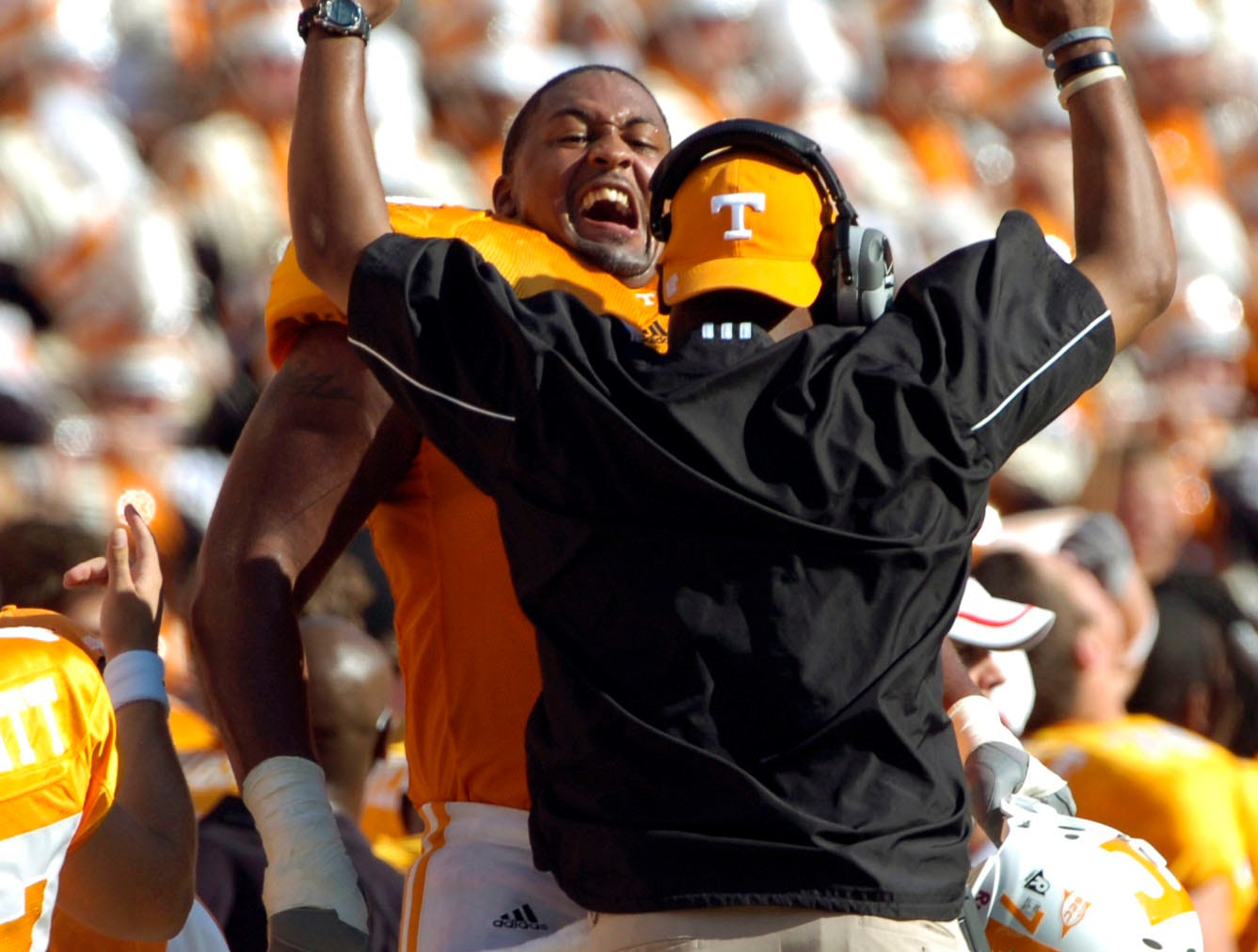 Tennessee offensive lineman Ramon Foster celebrates a score against Georgia with assistant coach Trooper Taylor on Saturday at Neyland Stadium. The Vols beat 12th-ranked Georgia 35-14, improving to 3-2 for the season.  Photo by Michael Patrick/Knoxville News Sentinel