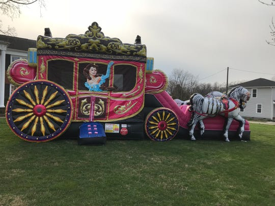 The Princess Chariot, more than 17 feet tall, is a hot item with the inflatables.