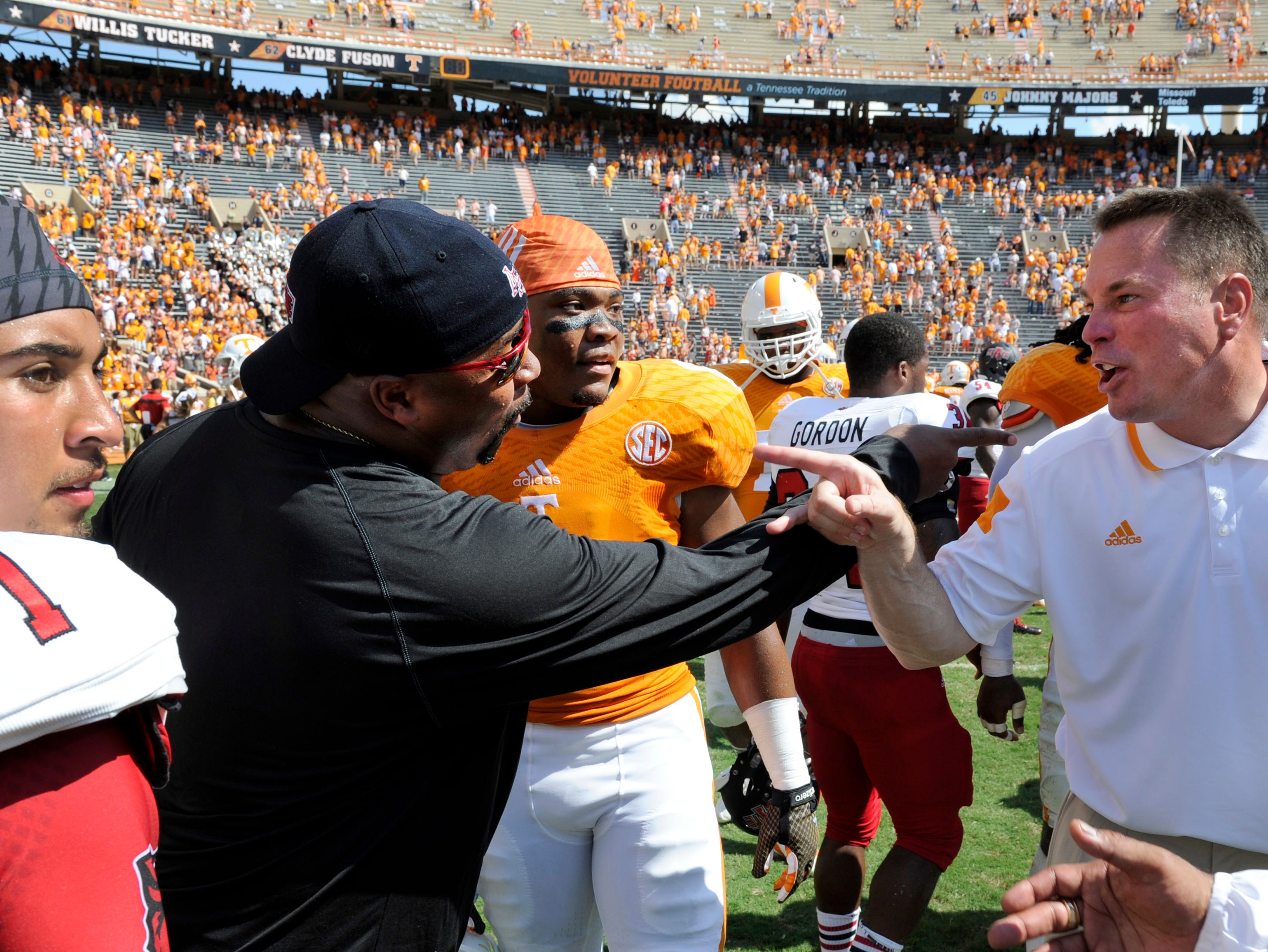 Arkansas State assistant coach Trooper Tayor and Tennessee coach Butch Jones gesture at each other following the game at Neyland Stadium, Saturday, Sept. 6, 2014 in Knoxville, Tenn.  MICHAEL PATRICK/NEWS SENTINEL