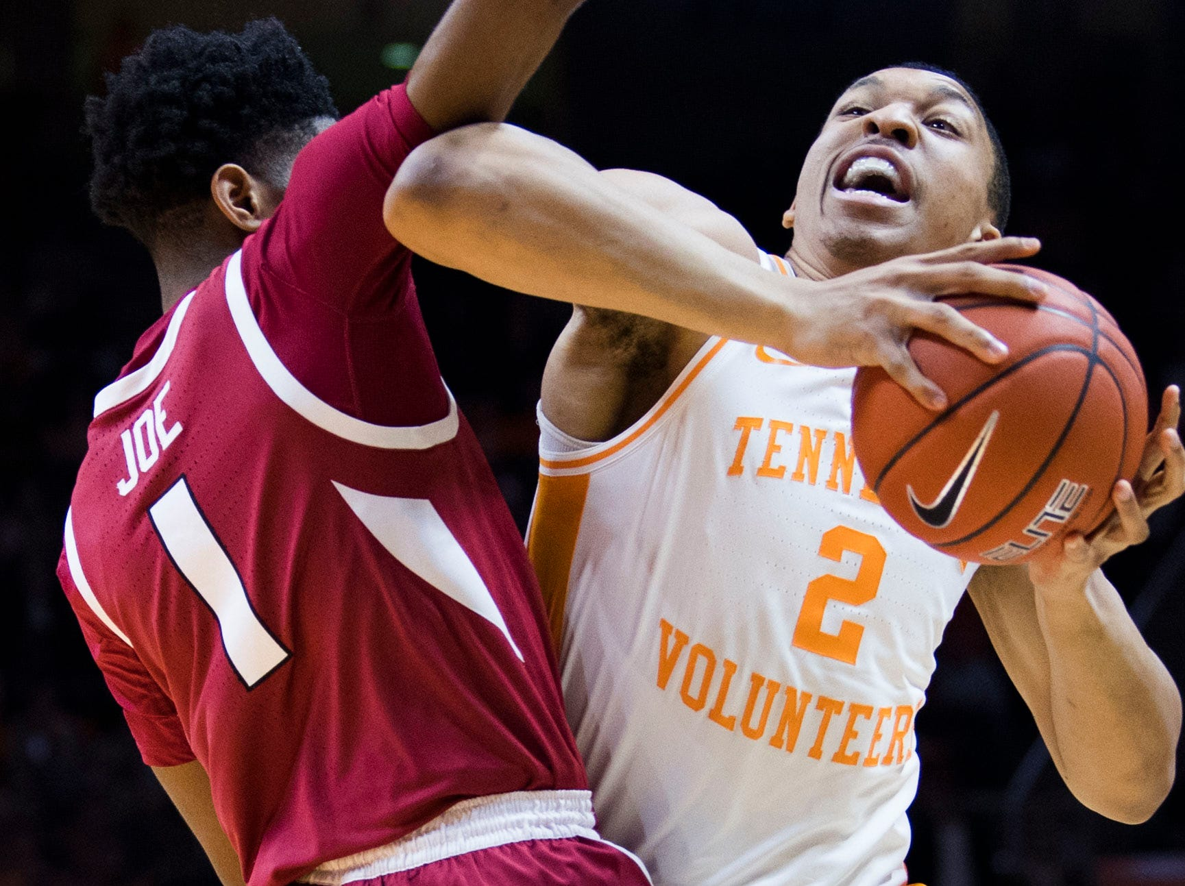 Tennessee's Grant Williams (2) takes a shot while defended by Arkansas' Isaiah Joe (1) during a NCAA men's basketball game between Tennessee and Arkansas at Thompson-Boling Arena Tuesday, Jan. 15, 2019.