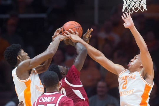 Tennessee's Kyle Alexander (11) and Tennessee's Grant Williams (2) fight for possession of the ball during a NCAA men's basketball game between Tennessee and Arkansas at Thompson-Boling Arena Tuesday, Jan. 15, 2019. Tennessee defeated Arkansas 106-87.