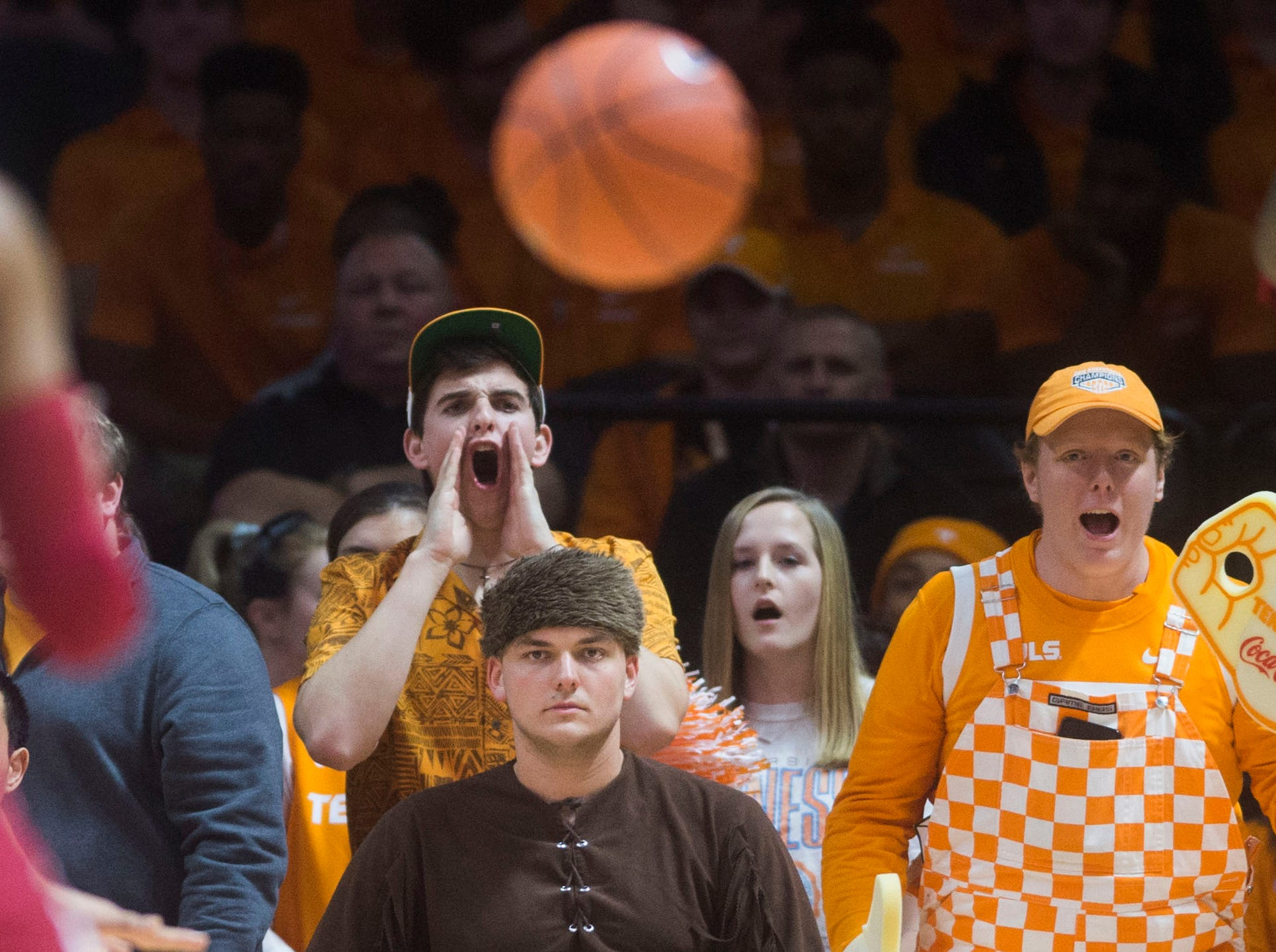 Fans yell during a NCAA men's basketball game between Tennessee and Arkansas at Thompson-Boling Arena Tuesday, Jan. 15, 2019.