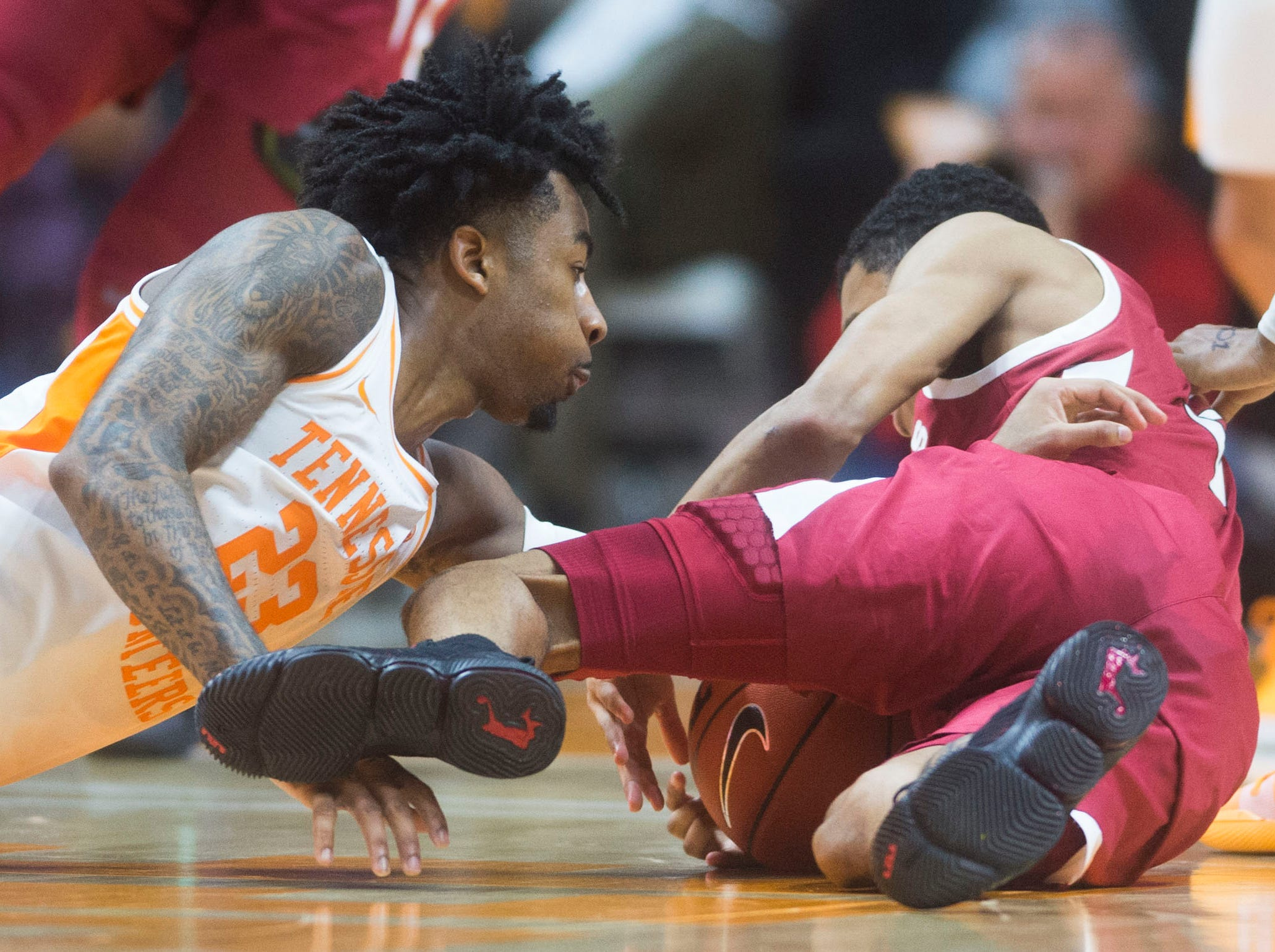 Tennessee's Jordan Bowden (23) fights for possession of the ball during a NCAA men's basketball game between Tennessee and Arkansas at Thompson-Boling Arena Tuesday, Jan. 15, 2019. Tennessee defeated Arkansas 106-87.