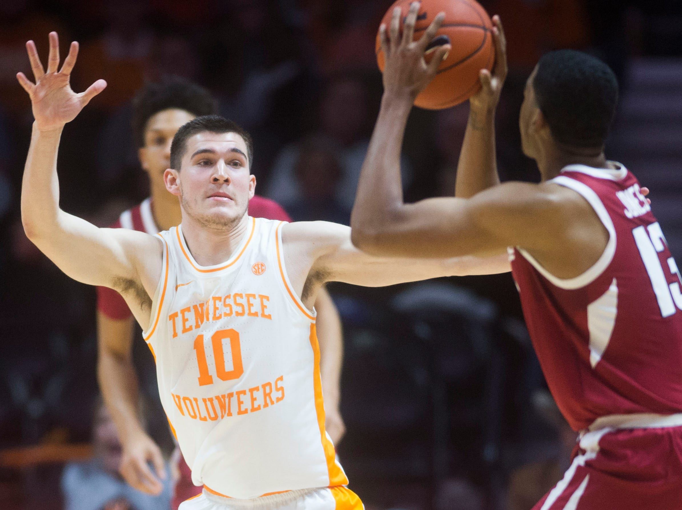 Tennessee's John Fulkerson (10) defends Arkansas' Mason Jones (13) during a NCAA men's basketball game between Tennessee and Arkansas at Thompson-Boling Arena Tuesday, Jan. 15, 2019. Tennessee defeated Arkansas 106-87.