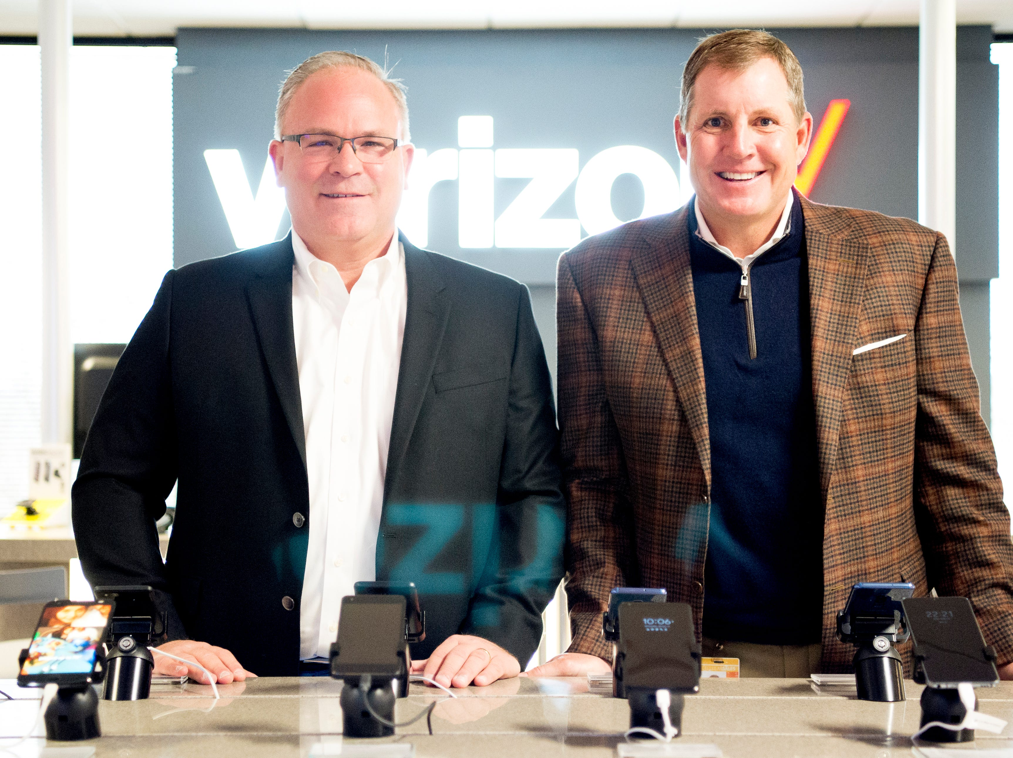 JT Thome, COO, and Dane Scism, CEO, pose for a photo inside the mock Verizon Wireless retail store setup inside the Cellular Sales headquarters on 9040 Executive Park Drive in West Knoxville, Tennessee on Wednesday, January 16, 2019. An authorized agent of Verizon Wireless, Cellular Sales specializes in retail and support for over 700 of Verizon stores in 42 states.