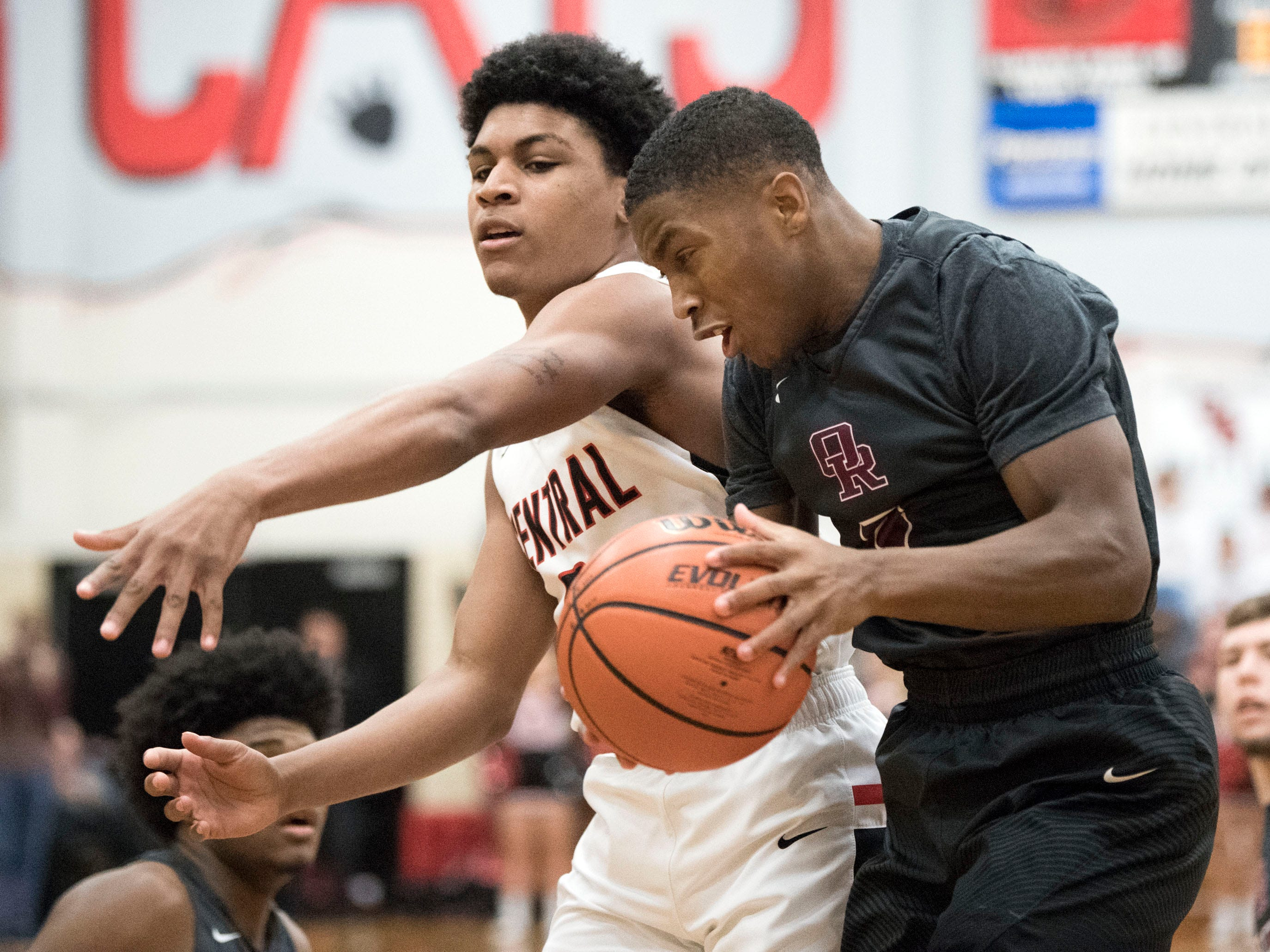 Oak Ridge's Marcus Smith (2) gets the rebound over Central's Tevon Summers (3) Central hosts Oak Ridge in basketball on Tuesday, January 15, 2019.