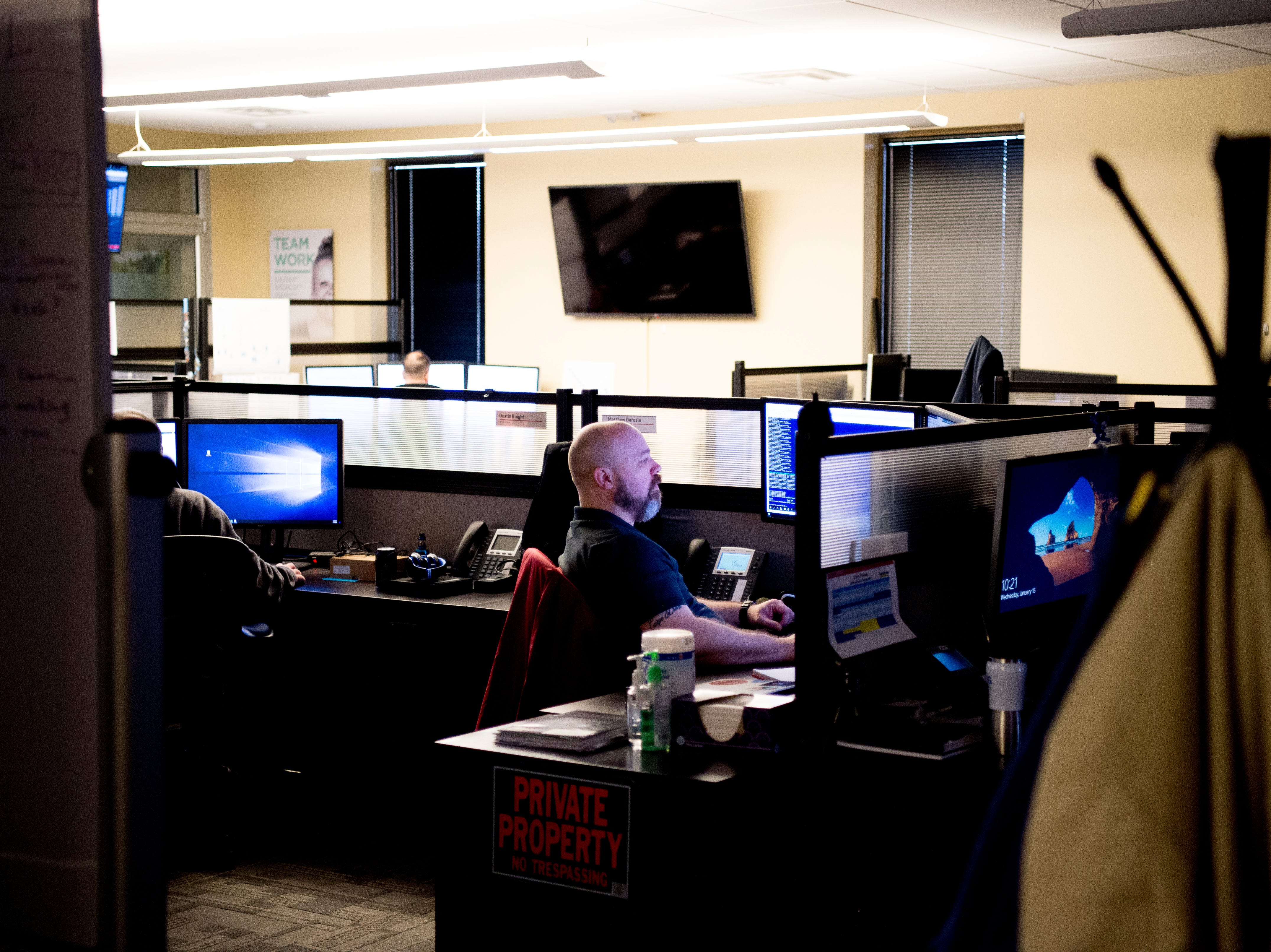 An employee works at their desk in the technology information management floor at the Cellular Sales headquarters on 9040 Executive Park Drive in West Knoxville, Tennessee on Wednesday, January 16, 2019. An authorized agent of Verizon Wireless, Cellular Sales specializes in retail and support for over 700 of Verizon stores in 42 states.