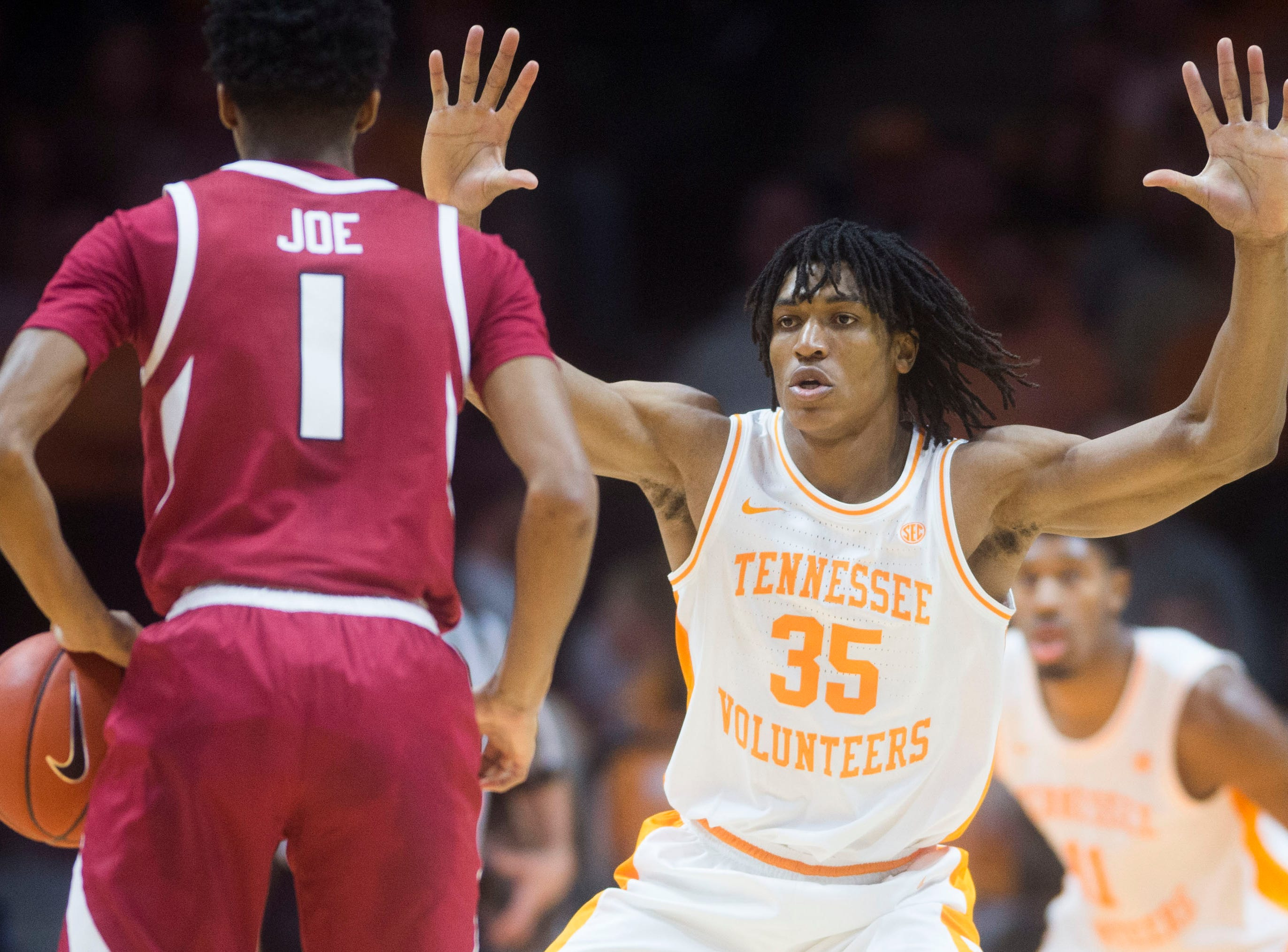 Tennessee's Yves Pons (35) defends Arkansas' Isaiah Joe (1) during a NCAA men's basketball game between Tennessee and Arkansas at Thompson-Boling Arena Tuesday, Jan. 15, 2019. Tennessee defeated Arkansas 106-87.
