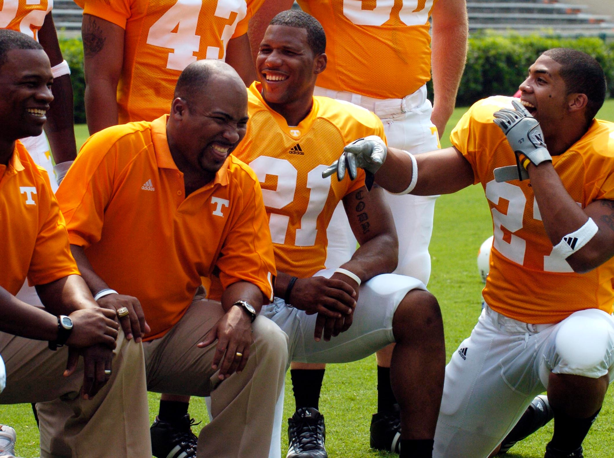 utfootball3.ASB#4056.JPG--SPORTS-- UT running backs (right to left) Arian Foster and Gerald Riggs, joke with coach Trooper Taylor and graduate assistant Jay Graham while taking a group photo during media day.