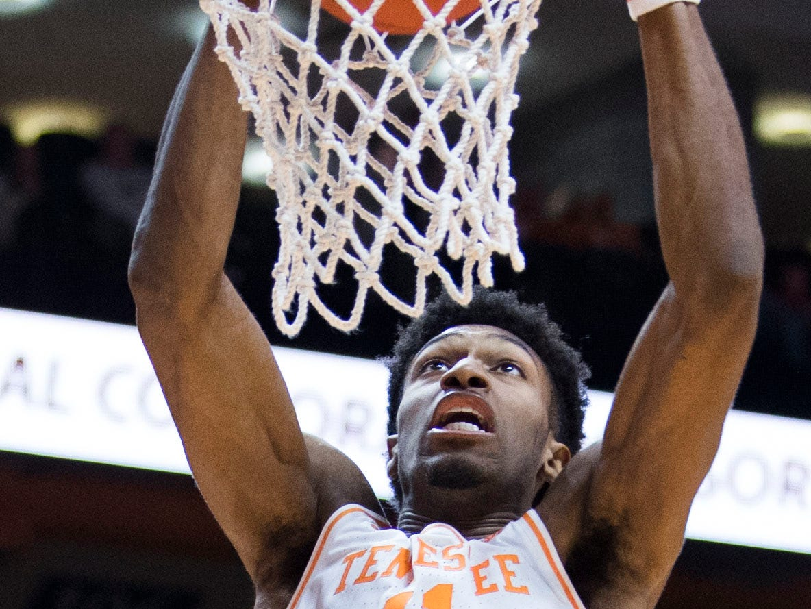 Tennessee's Kyle Alexander (11) dunks the ball during a NCAA men's basketball game between Tennessee and Arkansas at Thompson-Boling Arena Tuesday, Jan. 15, 2019. Tennessee defeated Arkansas 106-87.