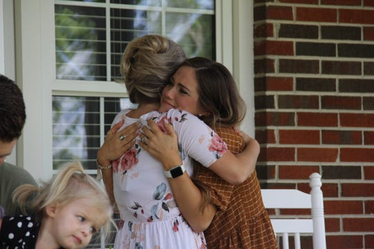 """Erin (Bates) Paine and Whitney Bates embrace each other on an episode of """"Bringing Up Bates."""""""