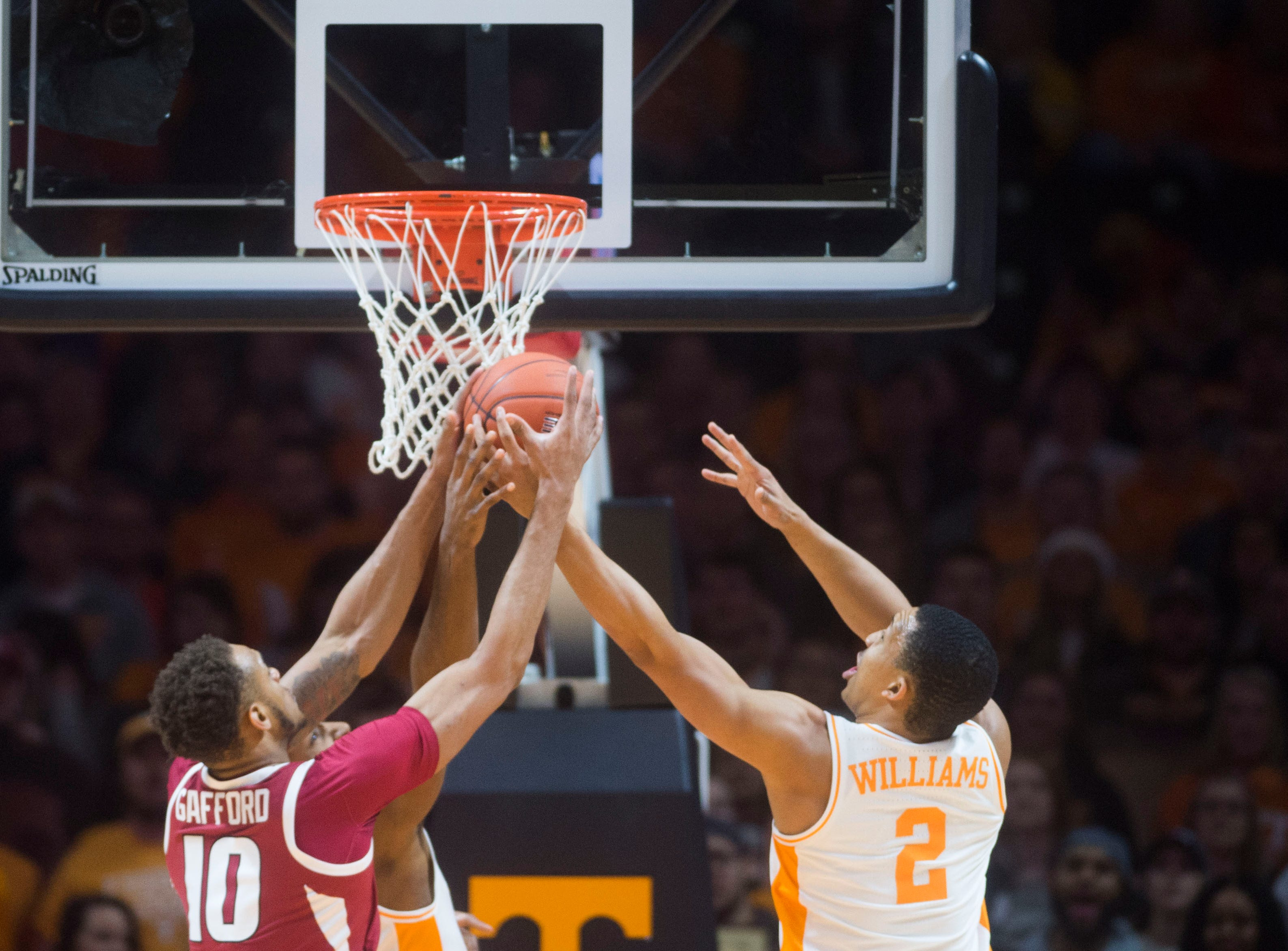 Tennessee's Grant Williams (2) blocks a shot by Arkansas' Daniel Gafford (10) during a NCAA men's basketball game between Tennessee and Arkansas at Thompson-Boling Arena Tuesday, Jan. 15, 2019.