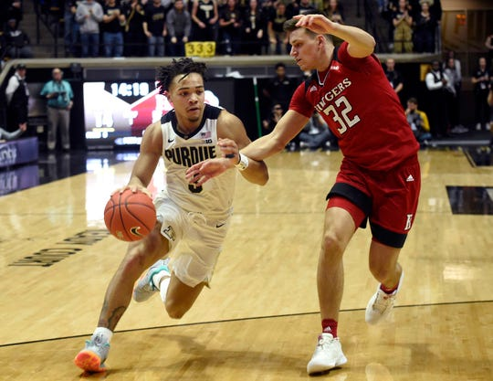 Purdue guard Carsen Edwards drives on Rutgers' Peter Kiss in the first half.