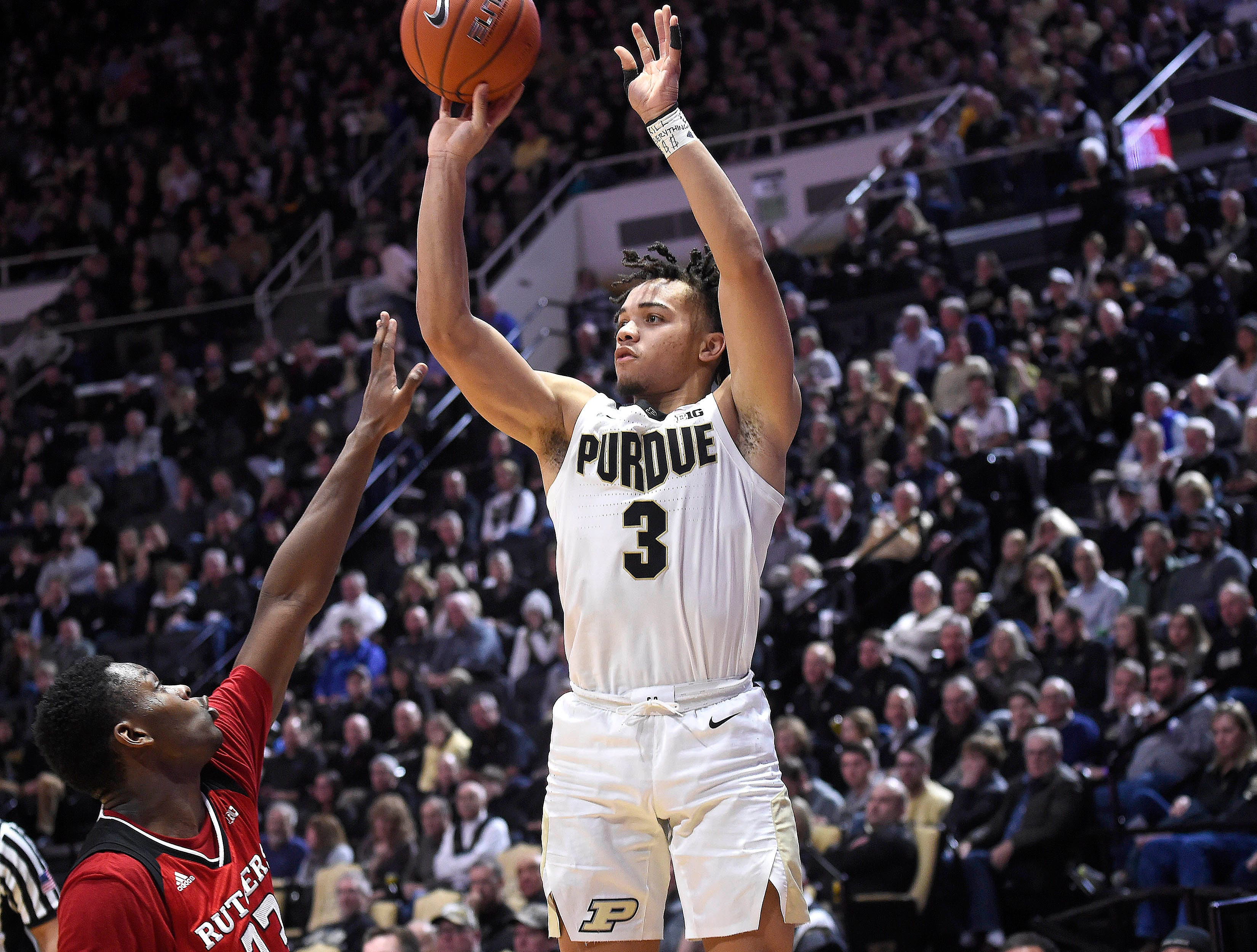 Jan 15, 2019; West Lafayette, IN, USA; Purdue Boilermakers guard Carsen Edwards (3) releases a shot over the defense of Rutgers Scarlet Knights guard Montez Mathis (23) in the 2nd half at Mackey Arena. Mandatory Credit: Sandra Dukes-USA TODAY Sports