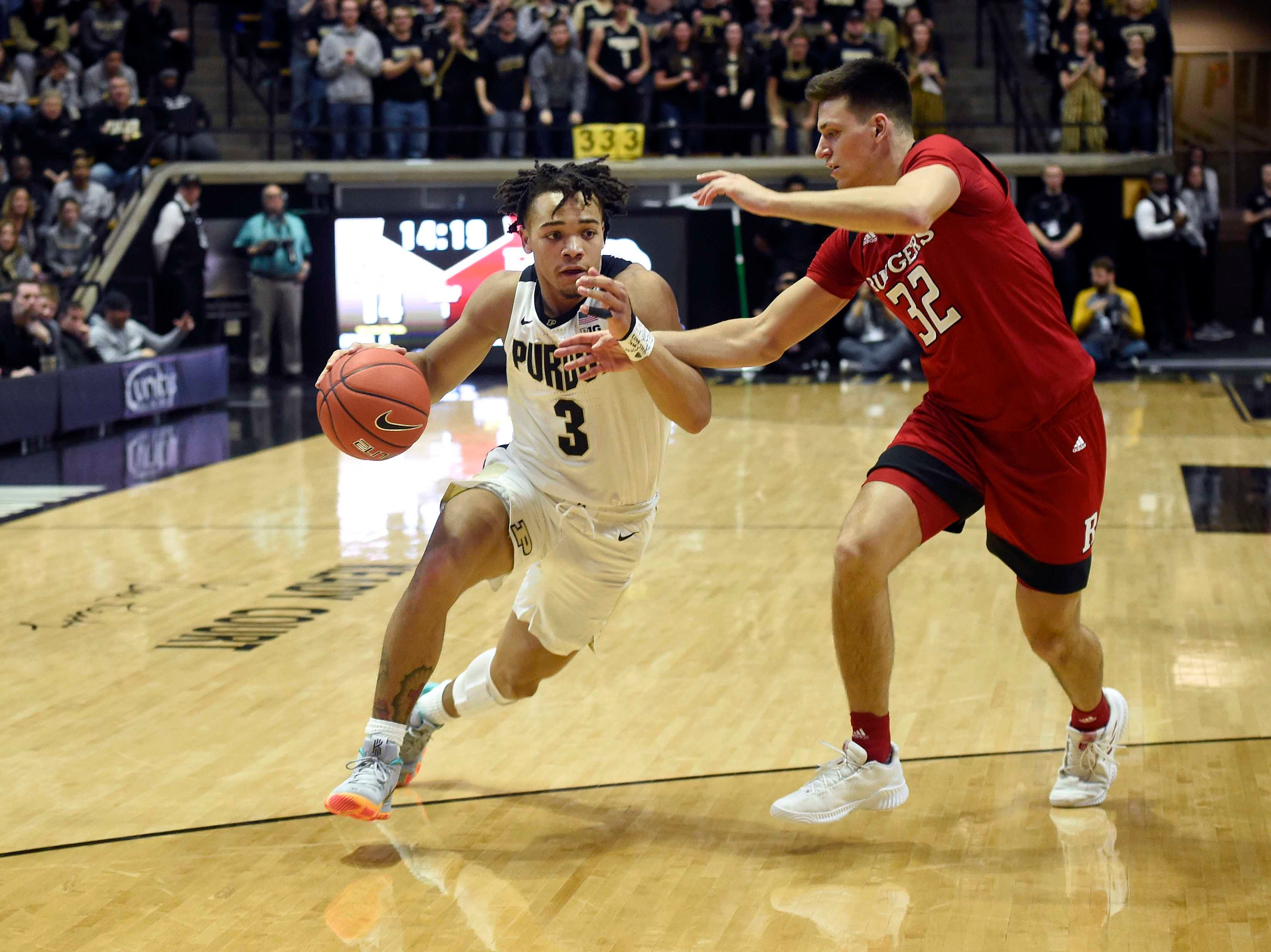 Jan 15, 2019; West Lafayette, IN, USA; Purdue Boilermakers guard Carsen Edwards (3) dries on Rutgers Scarlet Knights guard Peter Kiss (32) in the first half at Mackey Arena. Mandatory Credit: Sandra Dukes-USA TODAY Sports