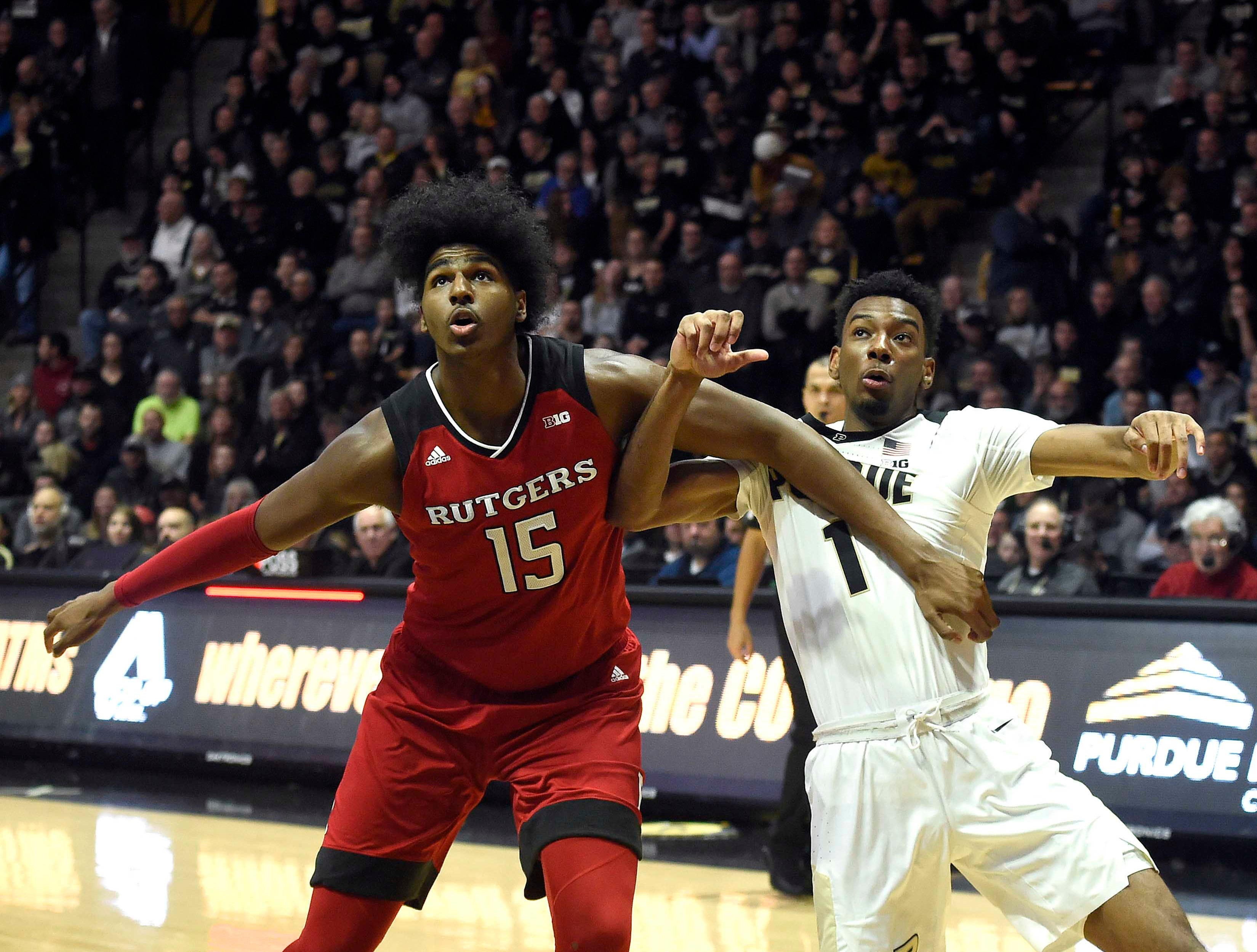 Jan 15, 2019; West Lafayette, IN, USA; Rutgers Scarlet Knights center Myles Johnson (15) and Purdue Boilermakers forward Aaron Wheeler (1) fight for a rebound in the first half at Mackey Arena. Mandatory Credit: Sandra Dukes-USA TODAY Sports