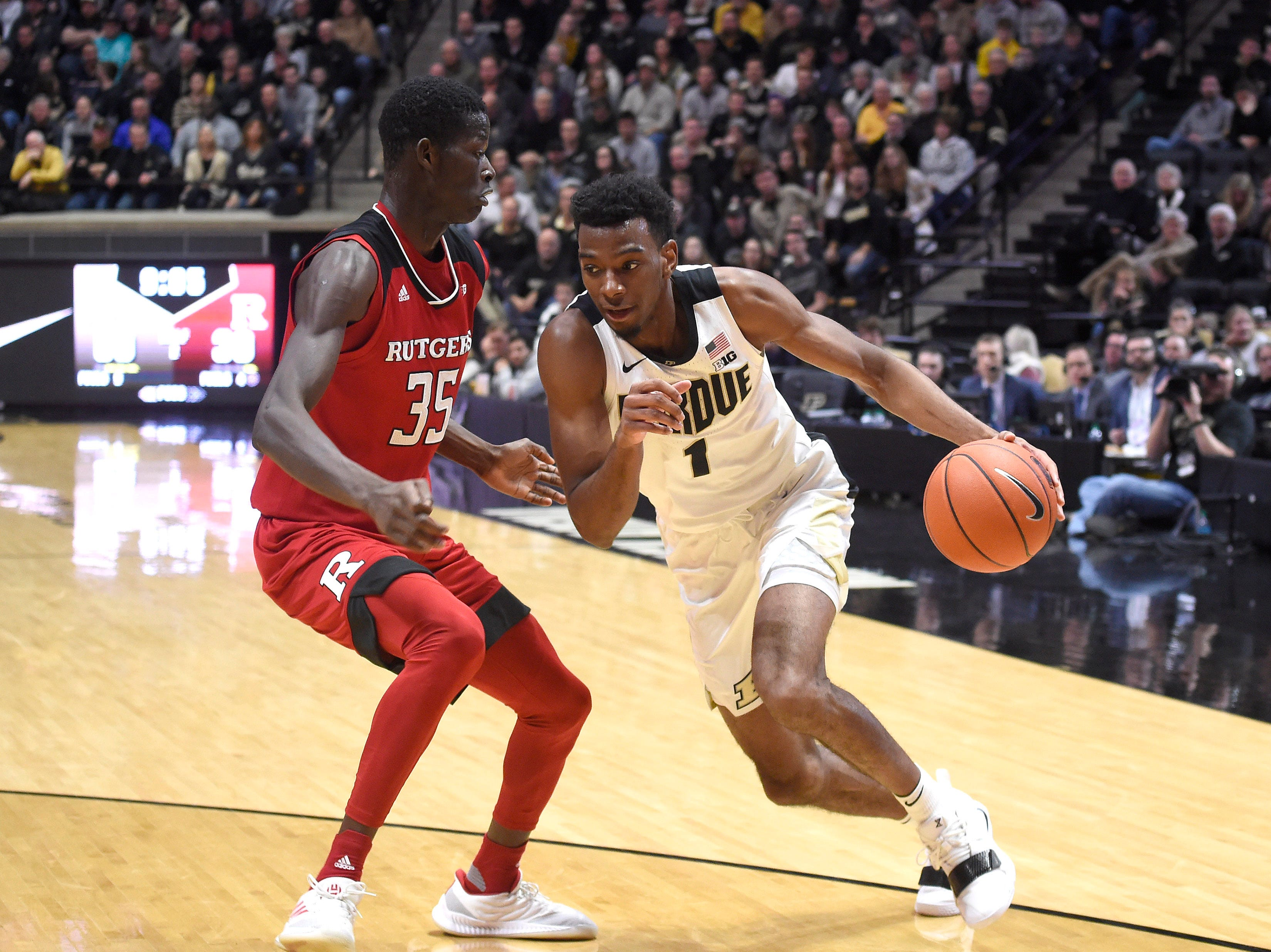 Jan 15, 2019; West Lafayette, IN, USA; Purdue Boilermakers forward Aaron Wheeler (1) drives past Rutgers Scarlet Knights forward Issa Thiam (35) in the 2nd half at Mackey Arena. Mandatory Credit: Sandra Dukes-USA TODAY Sports