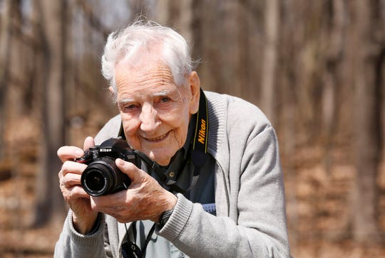 Camera always close at hand, retired botany professor Sam Postlethwait takes in the views at Celery Bog Thursday in West Lafayette. Postlethwait turns 100 years old on April 17.