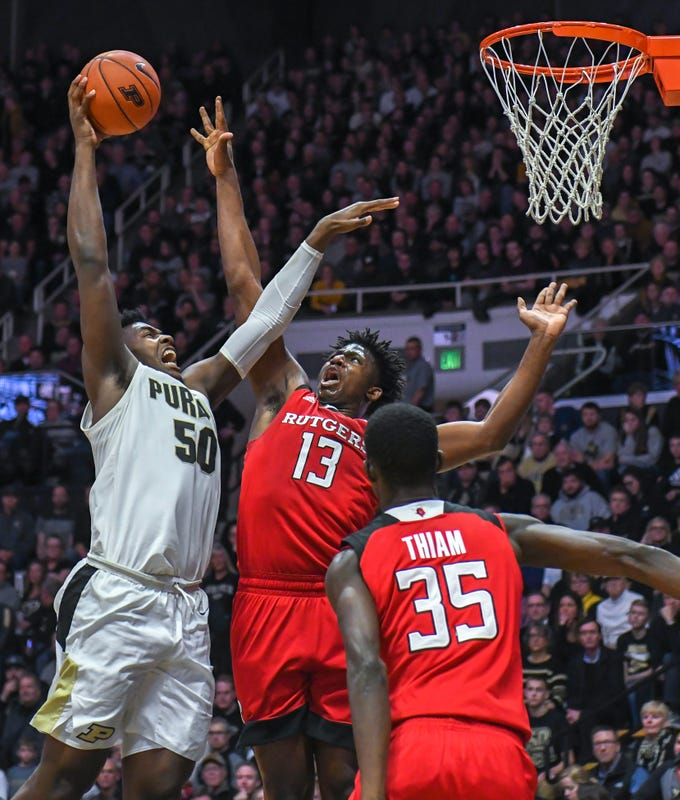 Purdue's Trevion Williams drives the lane for two points over Rutgers' Shaq Carter in the first half at Purdue University in West Lafayette on January 15, 2019.