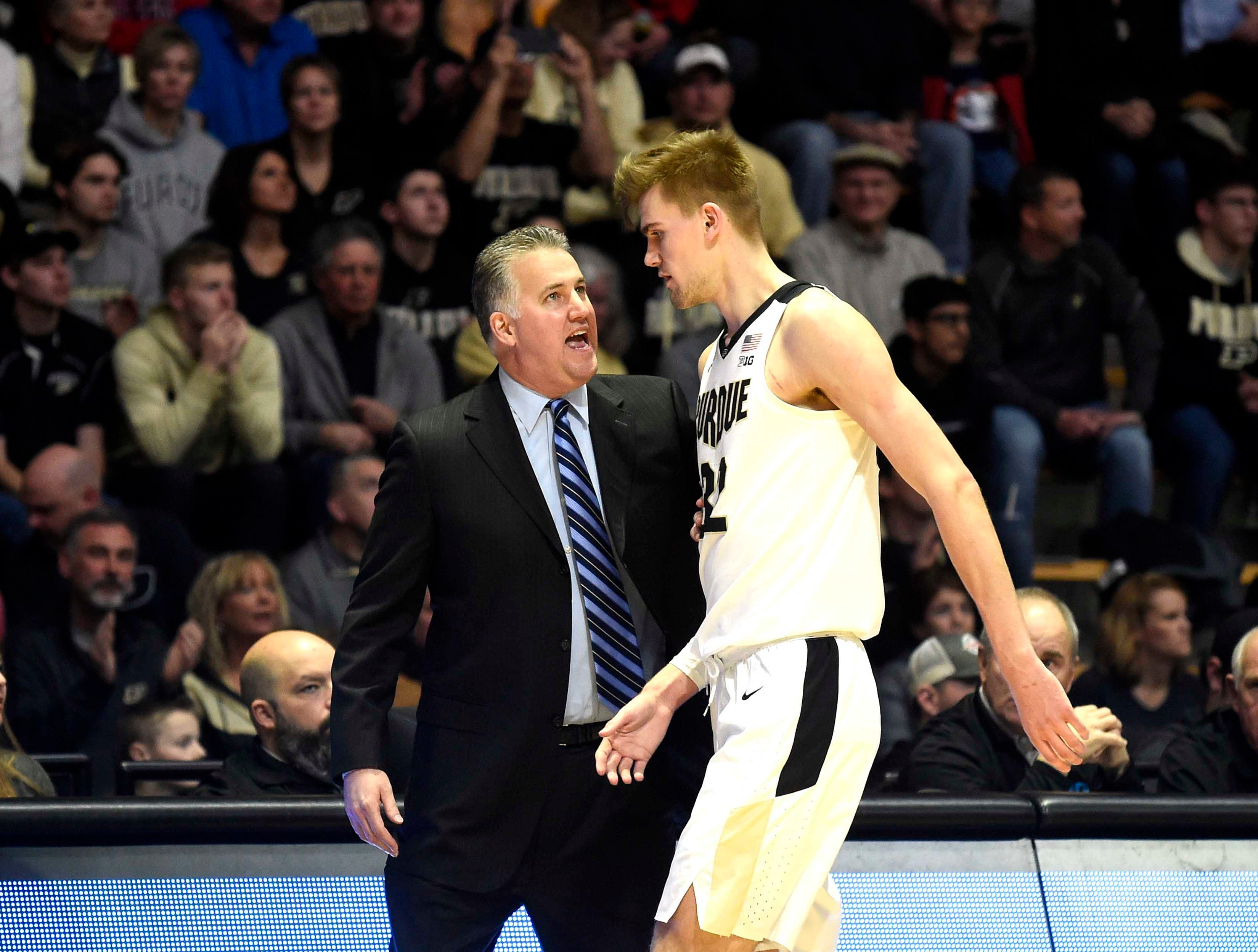 Jan 15, 2019; West Lafayette, IN, USA; Purdue Boilermakers head coach Matt Painter talks to Purdue Boilermakers center Matt Haarms (32) in the first half at Mackey Arena. Mandatory Credit: Sandra Dukes-USA TODAY Sports
