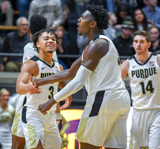 Purdue's Carsen Edwards, left, and Trevion Williams celebrate in the first half against Rutgers at Purdue University in West Lafayette on January 15, 2019.