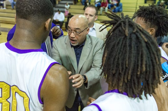 Westgate coach Oliver Winston talks to his team during Tuesday's game against St. Thomas More.