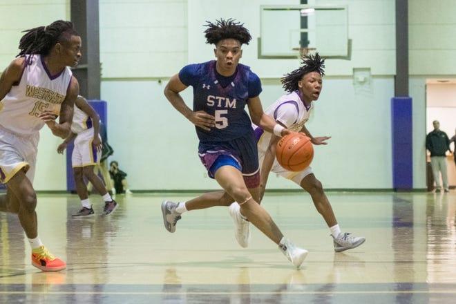 St. Thomas More sophomore Jaden Shelvin drives to the basket Jan. 15 against Westgate.