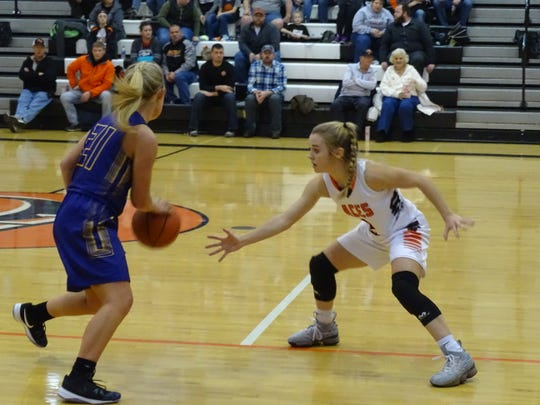 Amanda-Clearcreek's Kilynn Guiler defends against Bloom-Carroll's Maddy Wyant Tuesday night. The Aces held on for a 52-46 victory.