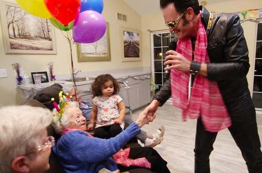 Cecilia Spalding is serenaded by Elvis impersonator Josh White at a party celebrating Spalding's 102nd birthday Tuesday, Jan. 16, 2019.