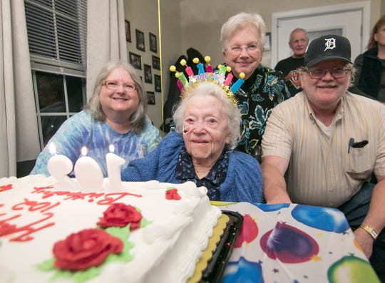102-year-old Cecilia Spalding celebrates her birthday with her children, from left, June Zimmerman, Janet Marks and Dale Spalding at Blue Heron Pond Adult Foster Care in Green Oak Township Tuesday, Jan. 15, 2019.