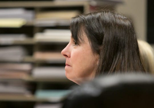 Judge Theresa Brennan listens to her attorney, Larry Willey, at a probable cause hearing before Genesee County Judge G. David Guinn in Flint Wednesday, Jan. 16, 2019.