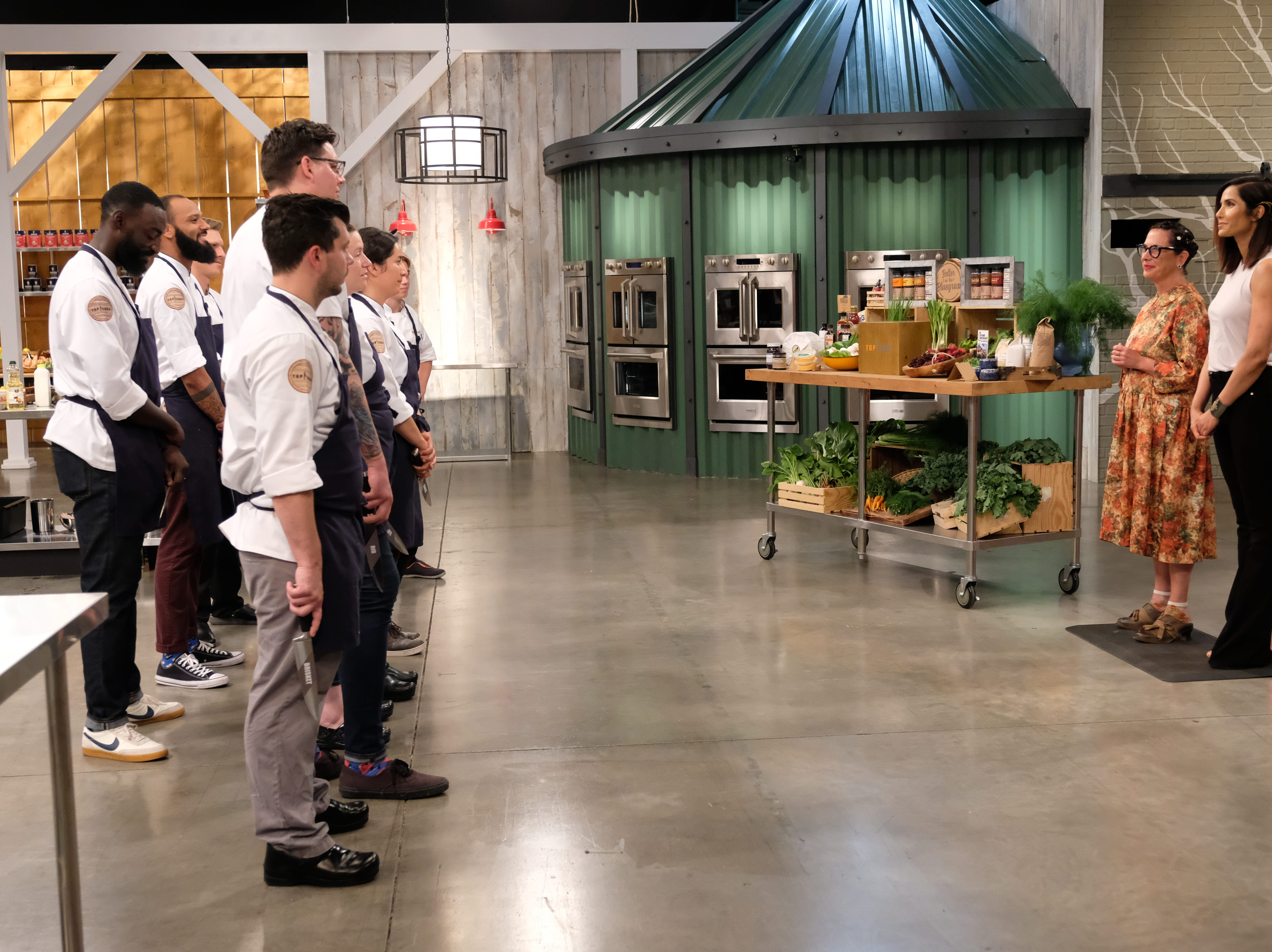 Contestants in the prep kitchen with chef Nancy Silverton and host Padma Lakshmi on episode 7 of Bravo's 'Top Chef: Kentucky.