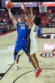 Jan 15, 2019; Athens, GA, USA; Kentucky Wildcats forward Reid Travis (22) shoots over Georgia Bulldogs forward Nicolas Claxton (33) during the second half at Stegeman Coliseum.