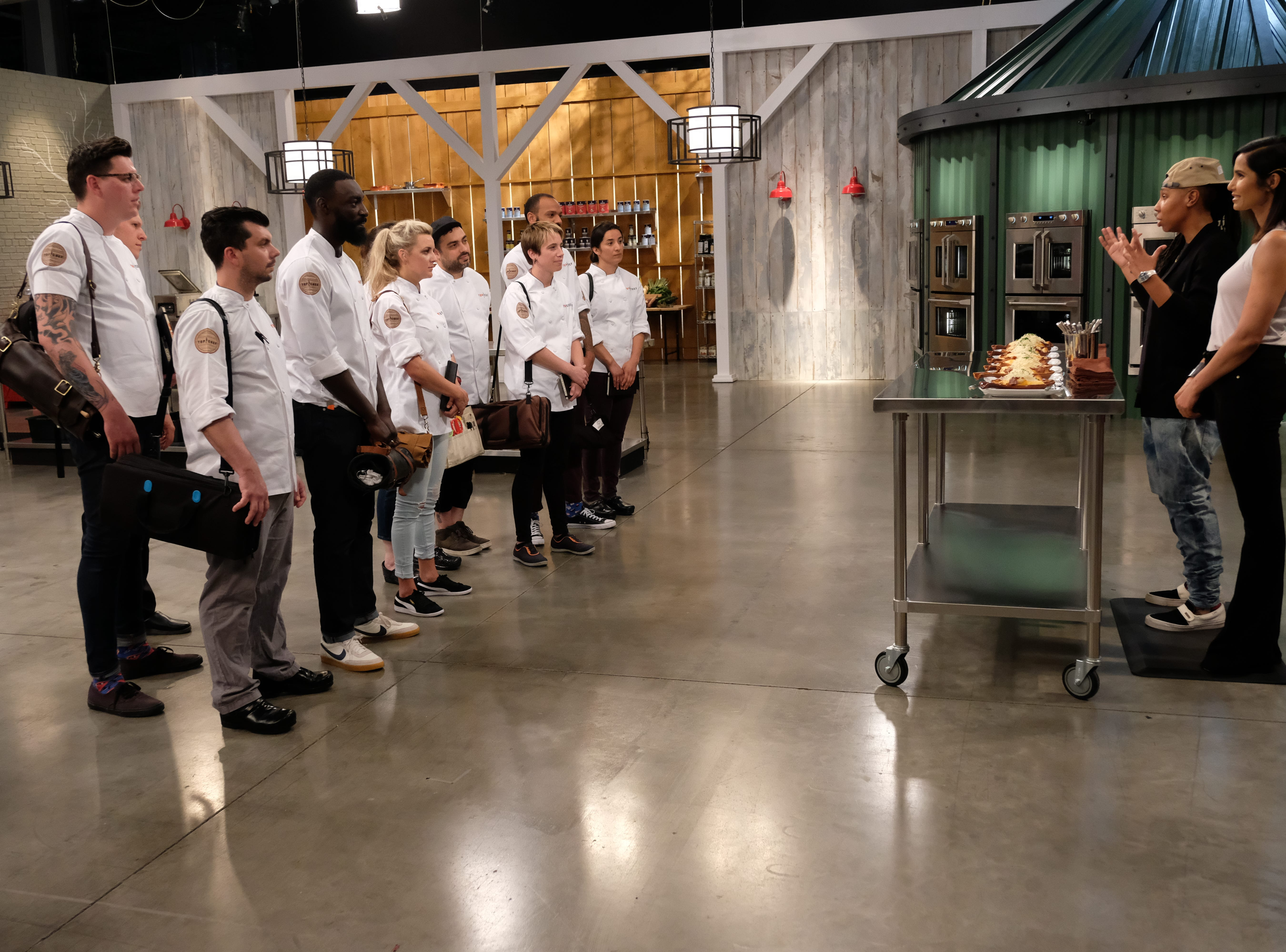 Contestants get instructions from Lena Waithe and host Padma Lakshmi on episode 7 of Bravo's 'Top Chef: Kentucky.'