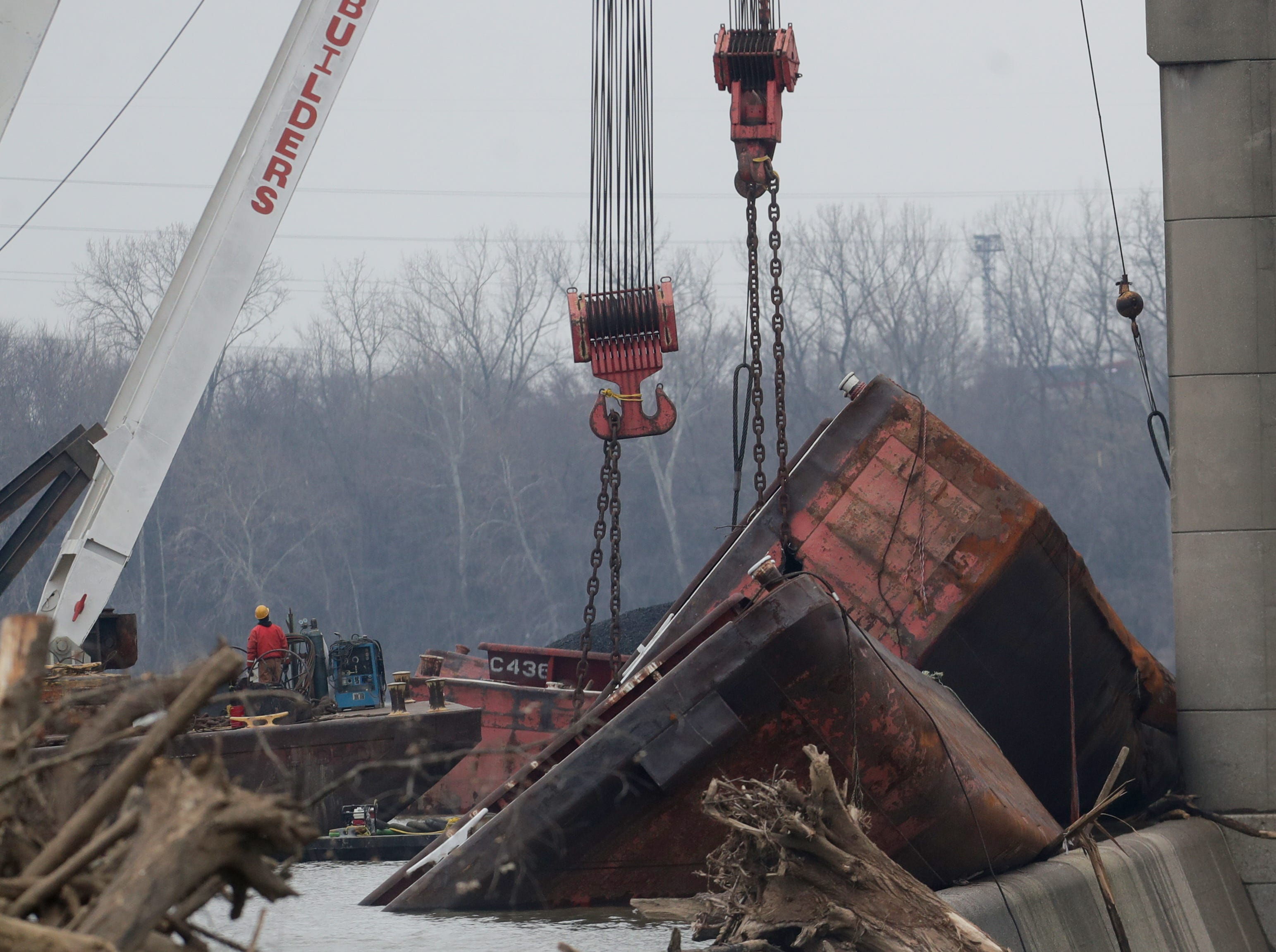 Salvage continues on the wrecked barges at the McAlpin Dam. 