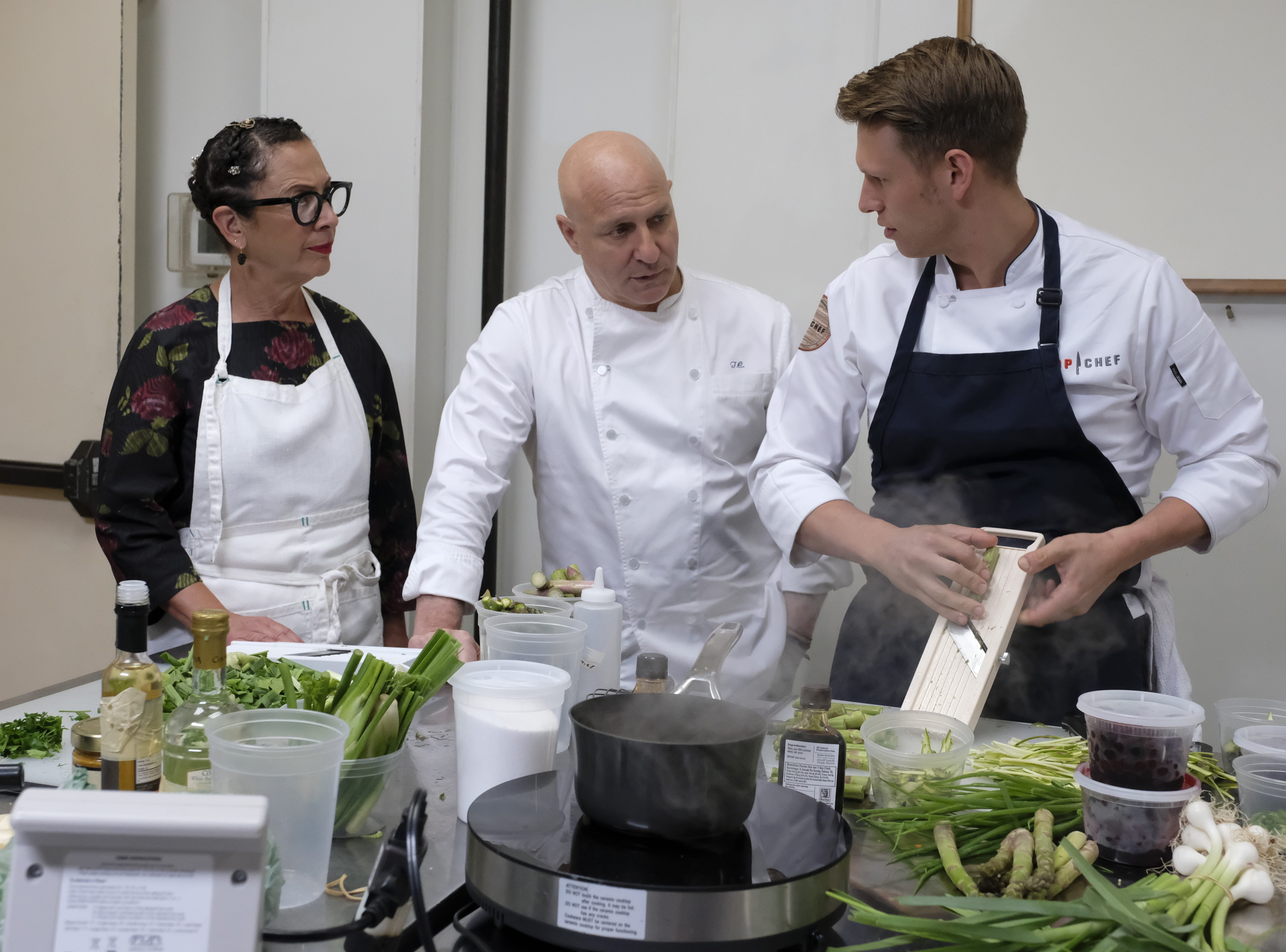 Contestant Brandon Rosen (left) talks to judge Tom Collicchio and super-chef Nancy Silverton on episode 7 of Bravo's 'Top Chef: Kentucky.